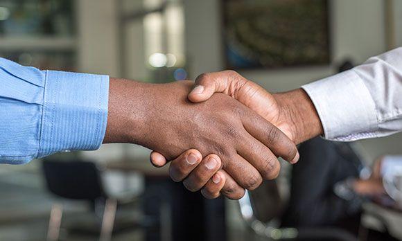 2 men shaking hands